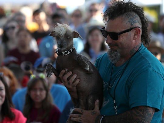 Jon Adler of Davis, California, holds his mixed breed