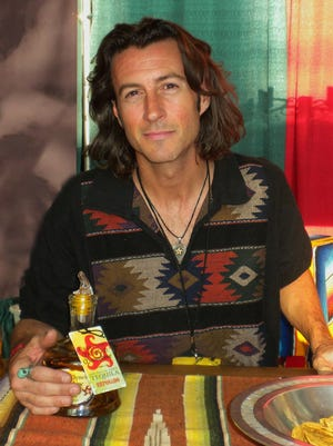 Roger Clyne with his Mexican Moonshine Tequila. He'll be serving it at Taco Guild on National Tequila Day, July 24.