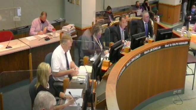 Springfield City Council members take a vote at their Sept. 15 meeting. Since June, plexiglass barriers have separated each member from each other as a precaution amid the COVID-19 pandemic.