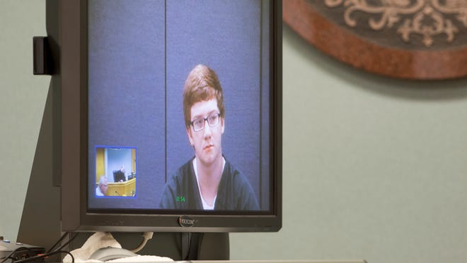 Dylan Carver, 15, makes his initial appearance in Portage County Circuit Court via video in Stevens Point, Monday, Aug. 1, 2016.