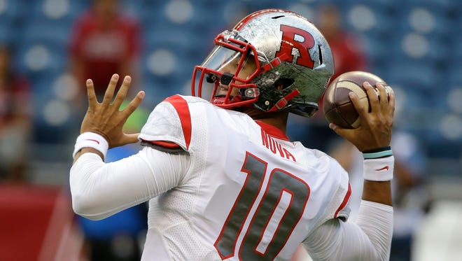 Rutgers quarterback Gary Nova launches his first pass of the game against Washington State, a 78-yard touchdown to Leonte Carroo on Aug. 28, 2014, in Seattle.