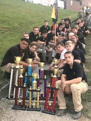 Fairview High JROTC cadets display trophies earned at the State Championship competition.
