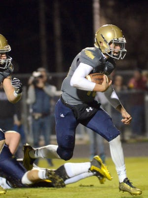 Independence High senior quarterback Andrew Bunch scrambles during first-quarter action on Friday November 13, 2015.