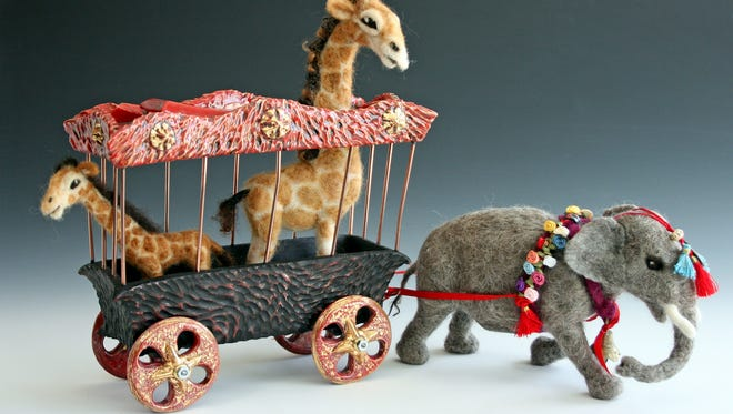 """This piece titled """"Big Top Parade' combined fiber and clay for the July Deming Arts Council show."""