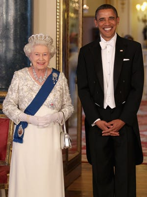 Queen Elizabeth II and then-U.S. President Barack Obama pose in the Music Room of Buckingham Palace ahead of a State Banquet on May 24, 2011 in London, England.