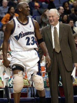John Bach, here with Michael Jordan in 2001, made his name in the NBA. But he also left a unique coaching legacy at Penn State. He died last week at 91.