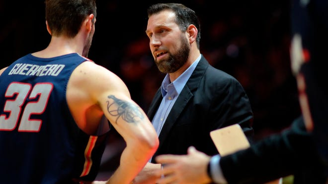 Samford head coach Scott Padgett speaks his center Ruben Guerrero during a time out in the first half of an NCAA college basketball game against Tennessee Wednesday, Dec. 19, 2018, in Knoxville, Tenn. (AP Photo/Shawn Millsaps)