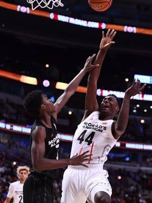 McDonalds High School All-American center Brandon McCoy (44) shoots the ball as teammate Brian Bowen (bottom left corner) watches at the United Center on March 29, 2017. Michigan State coach Tom Izzo is trying to land both Saginaw native Bowen and McCoy to complete the Spartans' 2017 recruiting class.