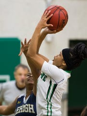 Destanni Henderson, of Fort Myers High School, shoots a jumpshot as she drives by her defender during the game Friday evening against Lehigh Senior High School. Fort Myers won with a final score of 58-44.