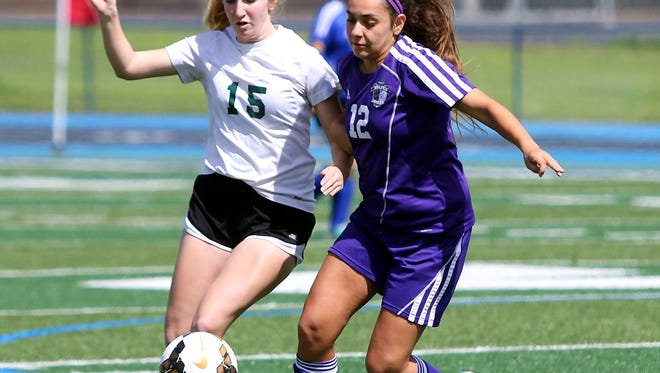 Miranda Avalos of Shasta, right, and Danica Kmiecik of Paradise fight for the ball in the Northern Section All Star game Saturday at Pleasant Valley High School in Chico.