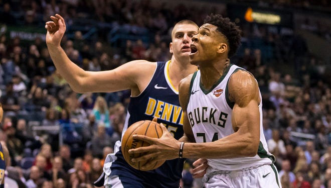 Bucks forward Giannis Antetokounmpo and Nuggets center Nikola Jokic put up some impressive numbers on Thursday night.