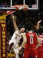Minnesota guard Amir Coffey (5) dunks during the second half of an NCAA college basketball game against Rutgers Saturday, Jan. 12, 2019, in Minneapolis. Minnesota defeated Rutgers 88-70. (AP Photo/Andy Clayton-King)