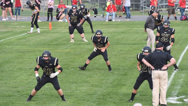 Buffalo Gap players warm up on the field prior to the start of the game against Riverheads in Swoope on Friday, Sept. 22, 2017.