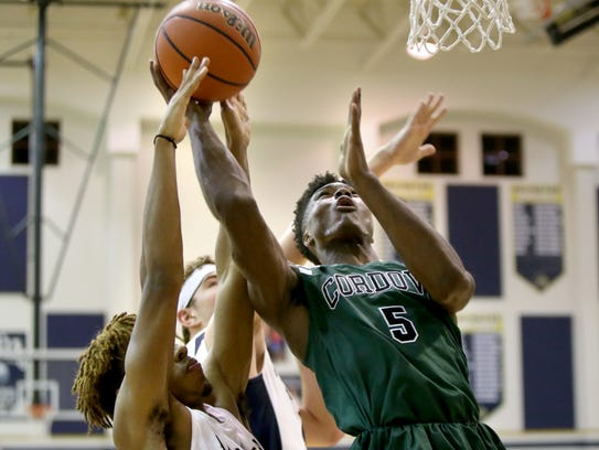 Cordova High's Rodgerick Brown, right, shoots against
