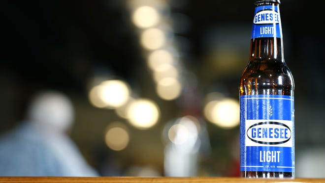 A Genny Light beer bottle on the bar at the Genesee Brew House.