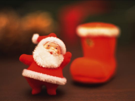 Santa Claus and Christmas stocking, front view, close up