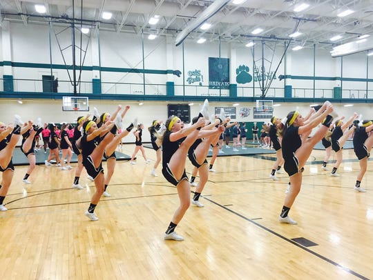 Hartland's competitive cheer team warms up for a routine