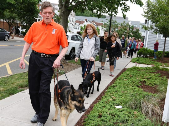 Jim and Ginger Kutsch lead the Seeing Eye Walking Tour in Morristown on June 23, 2018.
