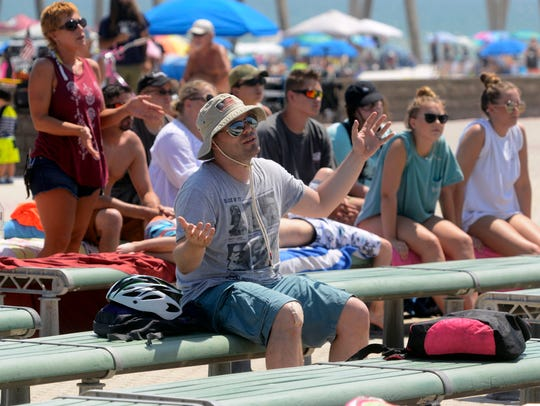 Fans listen to a performance at last year's Family Beach Fest. The festival, put on by Christian Surfers Pensacola, is back again this year from 2-8 p.m. Saturday at Pensacola Beach