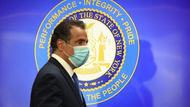 New York Gov. Andrew Cuomo arrives wearing a face mask for his daily briefing about the the state's coronavirus reopening process May 29, 2020 at Iona College in New Rochelle.