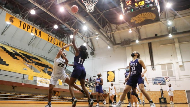 Topeka High sophomore Kiki Smith scores on a layup against Topeka West during Friday's game without fans inside Topeka High school on Dec. 11, 2020. Topeka Unified School District 501 will begin allowing two adults per student-athlete at games.