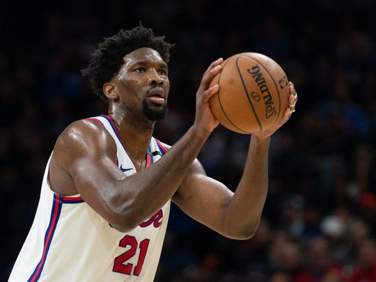 Feb 20, 2020; Philadelphia, Pennsylvania, USA; Philadelphia 76ers center Joel Embiid (21) shoots against the Brooklyn Nets during the second quarter at Wells Fargo Center. Mandatory Credit: Bill Streicher-USA TODAY Sports