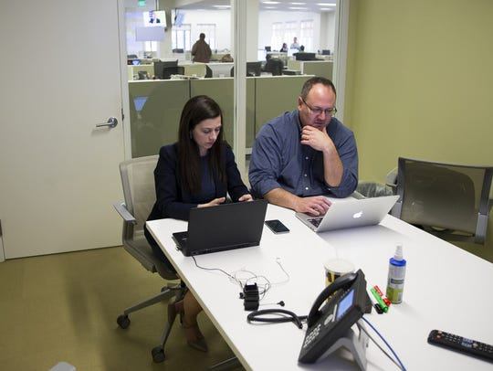 Marisa Kwiatkowski and Mark Alesia work on a story surrounding allegations of a pattern of sexual abuse related to USA Gymnastics last year.