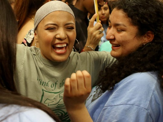 Osorio, left, and Erika Martinez of Elizabeth celebrated after Gov. Phil Murphy signed a law that extends financial aid to undocumented immigrants in May.