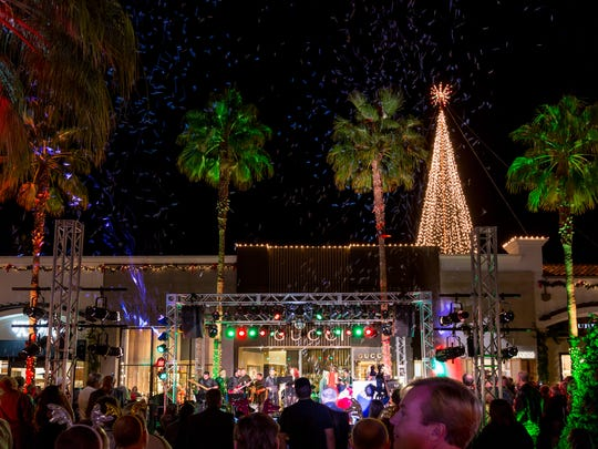 "The 60-foot Christmas tree is officially lighted as ""Joy to the World"" is sung by Citrus College's Nightshift and snow falls on the Bighorn  BAM Miracle on El Paseo."