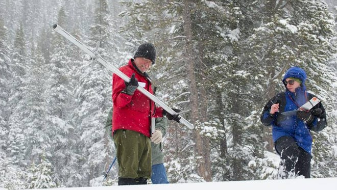 The California Department of Water Resources snow surveyors conduct winter's fourth snow survey at Phillips Station near Echo Summit on April 1, 2014.
