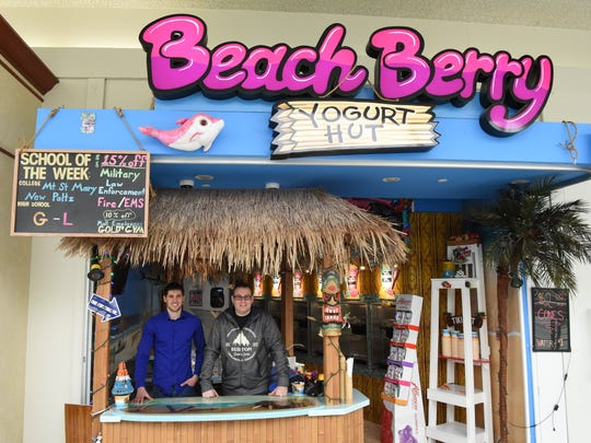 From left, Anthony Ratcliff and Ray Curtis, co-owners of Beach Berry Yogurt Hut at their store in the Poughkeepsie Galleria on Thursday.