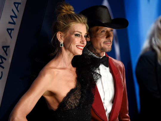 Faith Hill and Tim McGraw walk the red carpet at Music