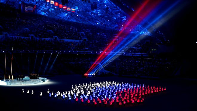 The Russian flag comes to life during Friday's opening ceremony of the Sochi Olympic Winter Games.