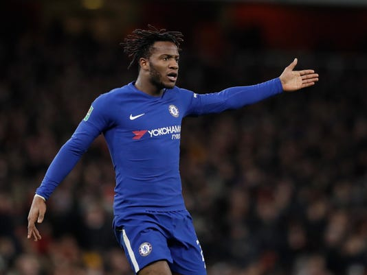 FILE - In this Wednesday, Jan.24, 2018 file photo, Chelsea's Michy Batshuayi gestures during the English League Cup semifinal second leg soccer match between Chelsea and Arsenal at the Emirates stadium in London. Michy Batshuayi has joined Borussia Dortmund on loan from Chelsea until the end of the season. The Belgium striker's move completes a triangle of transfers that saw Arsenal sign Pierre-Emerick Aubameyang from Dortmund and sell Olivier Giroud to Chelsea earlier on Wednesday, Jan. 31, 2018. (AP Photo/Matt Dunham, file)