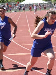 Hondo Valley's Joyce Anne  Cooper takes off as Kyra Lucero prepares to make the hand off in the 4 X 200 m relay.