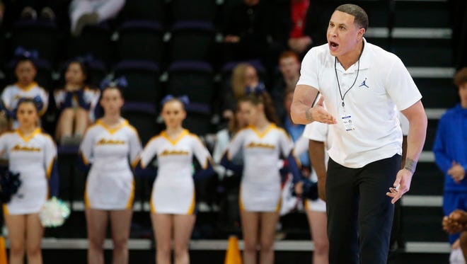 Shadow Mountain head coach Mike Bobby talks to his team during the 4A Boys state championship basketball game against Salpointe in Phoenix on February 24, 2018.