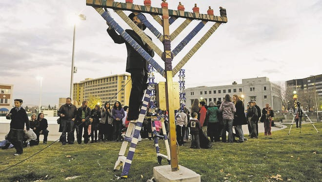 Rabbi Mendel Cunin of the Chabad of Northern Nevada lights the menorah in downtown Reno in 2010 to mark the first day of Hanukkah.