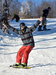 Snowboarders enjoy the slopes Thursday, at Whitetail