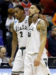 Denzel Valentine walks off the court, consoled by teammate Javon Bess, after the Spartans' first-round NCAA tournament loss to Middle Tennessee. The unthinkable hasn't gotten much easier a week later.