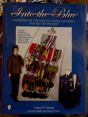 Air Force medals on the cover of the book 'Into the Blue: Uniforms of the United States Air Force 1947-to the Present' belong to Jim Harding.