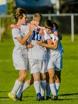 Erik Seelman (10) is embraced by some of his Grand Ledge teammates after scoring with 10:39 remaining in the first half of a CAAC Gold Cup first-round game earlier this month against Jackson. It wound up being the only goal of the game.