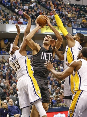 Brooklyn Nets center Brook Lopez (11) gets a shot off over Indiana Pacers center Myles Turner (33) in the first half at Bankers Life Fieldhouse on Thursday, Jan. 5, 2017.