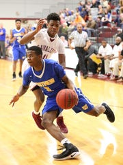 Westview's B.J. White drives to the basket against