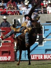 Clint Corey of Powell Butte, Ore., rides Been Cut to