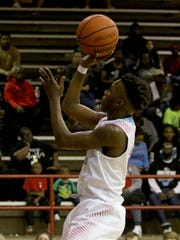 Hirschi's Mark Harrell shoots in the game against Bowie