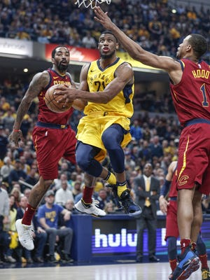 Indiana Pacers forward Thaddeus Young (21) drives to the basket against the Cleveland Cavaliers during the first half of Game 4 at Bankers Life Fieldhouse on Sunday, April 22, 2018.
