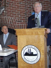 In this Sept. 2012 file photo, Bill Stenger, right,