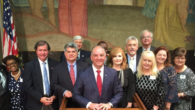 The Central Louisiana Regional Chamber of Commerce held its annual Central Louisiana Day at the Legislature Tuesday. Camber members met with state officials throughout the day. Pictured are (front row, from left) June Johnson Davis, Sen. Neil Riser, Alexandria Mayor Jacques Roy, Gov. John Bel Edwards, Deborah Randolph, Sylvia Coody, Linda Carpenter and Brenda Sartin.  (Back row, from left) Sen. Gerald Long, Pineville Mayor Clarence Fields, Kermit Pharris, and Jim Smilie.
