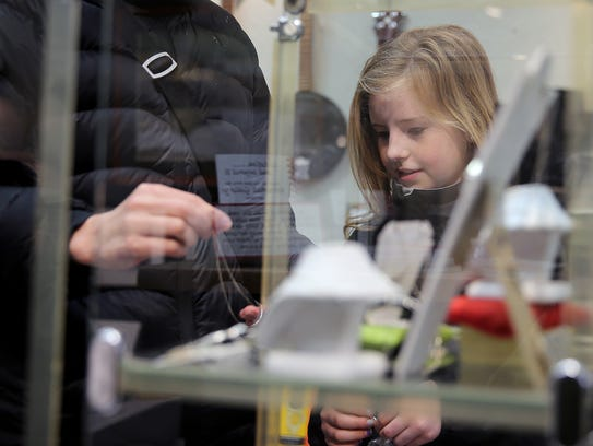 Mira Sonnen, 10, of Gig Harbor looks at a necklace
