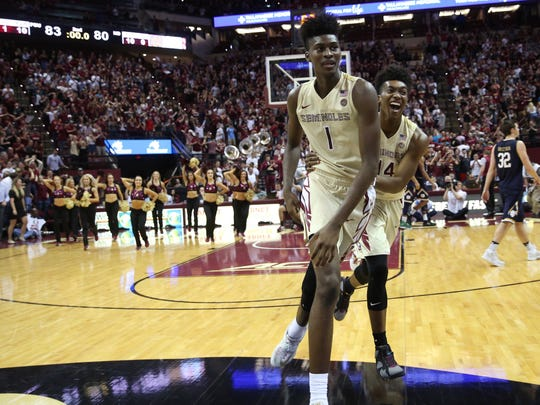 FSU's Jonathan Isaac and Terance Mann run off the court after defeating Notre Dame 83-80 at the Tucker Civic Center on Wednesday, Jan. 18, 2017.